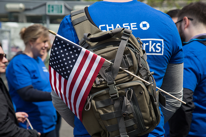 JPMorgan Chase employee wearing a backpack with a U.S. flag attached