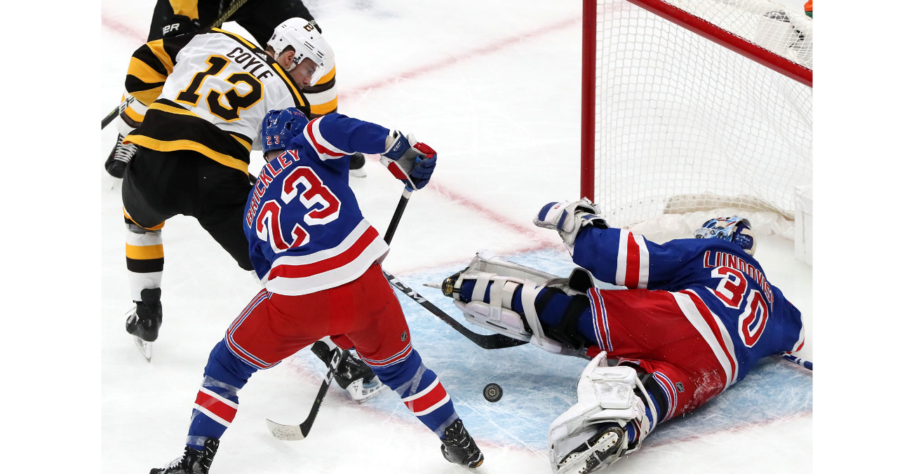 New York Rangers goaltender Henrik Lundqvist (30) makes a first period save on a shot by Boston Bruins center Charlie Coyle (13). The Boston Bruins host the New York Rangers in a regular season NHL hockey game at TD Garden in Boston on March 27, 2019.